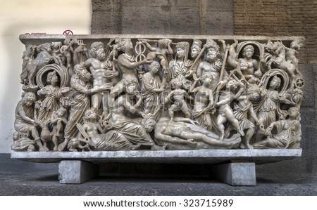 NAPLES, ITALY - JULY 22 2015: 4th century AD Roman sarcophagus depicting the legend of Prometheus creating the first man on display in the Naples National Archaeological Museum. - stock photo