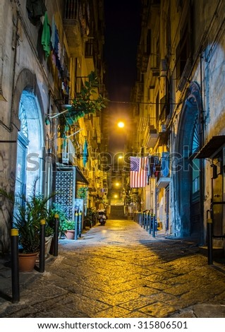 NAPLES, ITALY, JUNE 28, 2014: night view of illuminated street leading through the historical center of italian city naples - napoli.