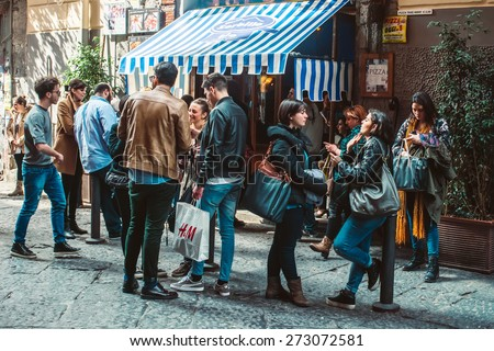 NAPLES, ITALY - MARCH 20, 2015: People standing near famous pizzeria in the historical center of Naples, Italy - stock photo