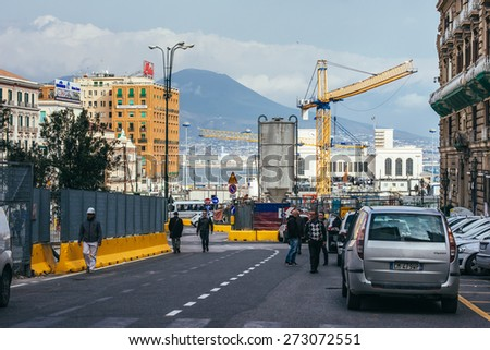 NAPLES, ITALY - MARCH 20, 2015: View on port and Vesuvius mountain. Naples is the the third-largest city in Italy with about 1 million residents