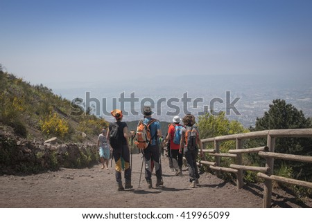 NAPLES, ITALY - MAY 2016: People on the walking path to the top of the Vesuvius volcano in Ercolano near Naples in Italy - stock photo