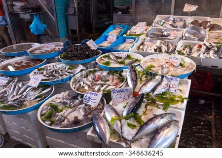 NAPLES, ITALY - MAY 7, 2015: Typical outdoor Italian fish market with fresh fish and seafood on the streets of Naples city, Italy - stock photo