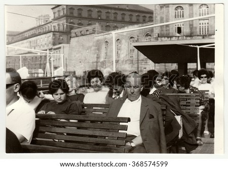 NAPLES, ITALY - MAY, 1969: Vintage photo shows people on vacation.
