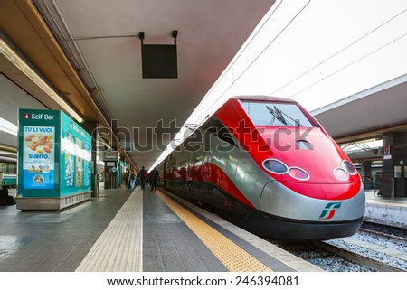 NAPLES, ITALY - NOVEMBER 30, 2014: Napoli Centrale railway station. Freccia Rossa bullet train 300 km/h. - stock photo