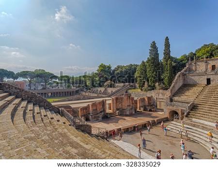 Naples, Italy - September 8, 2014: view of the ruin of amphitheatre - theatre in italian pompeii - stock photo