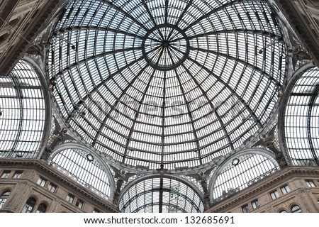 NAPLES - JAN 30: Galleria Umberto Primo interior on january 30, 2013 in Naples, Italy. This gallery is an elegant glass-and-iron covered passage following a Greek cross shape