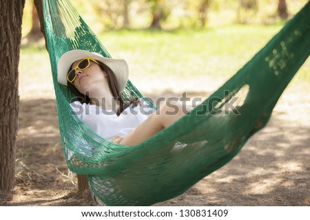 Napping in a hammock outdoors - stock photo
