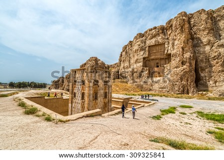 NAQSH-E RUSTAM, IRAN - MAY 3, 2015: The historical monuments of ancient necropolis near ruins of old city Persepolis.