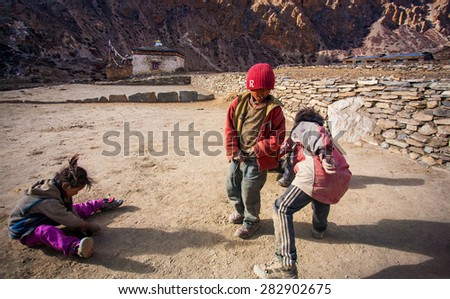 NAR, NEPAL - OCTOBER 31: Unidentified Tibetan children on the famous Annapurna trail on October 31, 2008, in Nar village, Nepal. The majority of the local population are Tibetans.