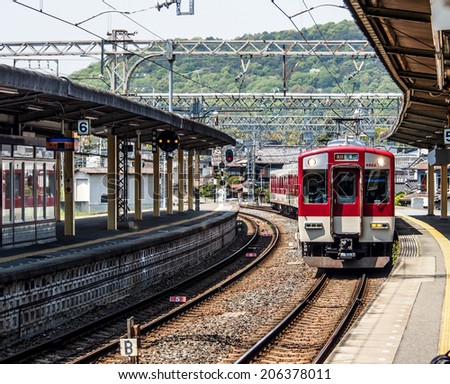 NARA -APR 19: Local train at a station on Apr 19, 2014 in Nara, Japan. Rail transport services in Japan are provided by more than 100 private companies - stock photo