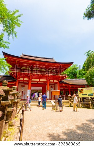 NARA, JAPAN - JUNE 24, 2015: People entering front door gate of Kasuga-Taisha Shinto shrine on Todai-ji temple complex