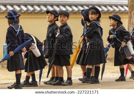 NARA,JAPAN, NOVEMBER 18, 2011: Japanese young students are coming back from elementary school in Nara near Kyoto, Japan. - stock photo