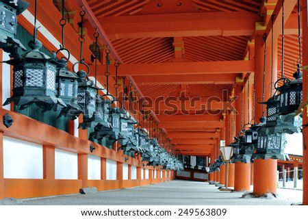 NARA,JAPAN-NOVEMBER 2014; Kasuga Taisha Shrine is famous for its lanterns Hundreds of bronze lanterns are hanging from the buildings .It is an UNESCO World Heritage site.November 6, 2014 Nara, Japan - stock photo