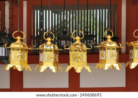 NARA,JAPAN-NOVEMBER 6, 2014; Kasuga Taisha Shrine is famous for its lanterns Hundreds of bronze lanterns are hanging from the buildings .It is an UNESCO World Heritage site.November 6,2014 Nara, Japan - stock photo