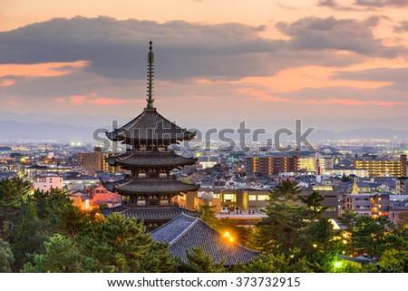 Nara, Japan pagoda and cityscape at dusk. - stock photo