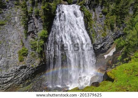 Narada Falls with beautiful rainbow in Mt, Rainier National Park - stock photo