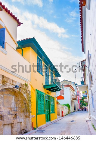 Narow road with beautiful historic buildings in Nafplio town in Greece - stock photo