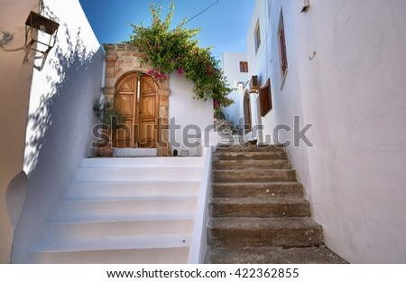 Narrow alley and traditional Greek architecture of Lindos, Rhodes Island, Greece - stock photo