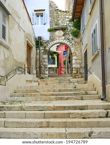 Narrow alley in Rovinj. Rovinj is a major tourist center in Croatia and the historic old city on the Adriatic Coast. Istria, Croatia - stock photo