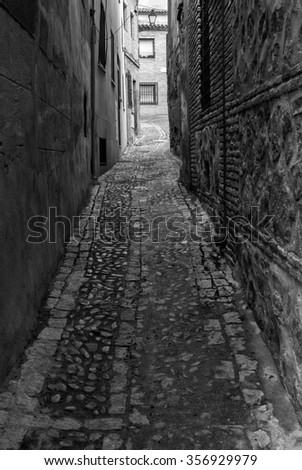 Narrow alley in the old town of Toledo. Spain.