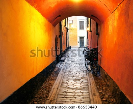 Narrow alley with archway in the Old Town of Stockholm, sweden - stock photo