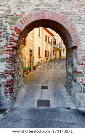 Narrow Alley with Old Buildings in Italian City  - stock photo