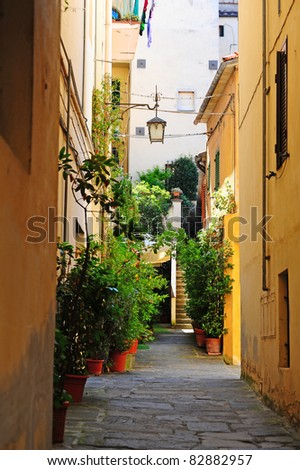 Narrow Alley With Old Buildings In Italian City of Arezzo - stock photo