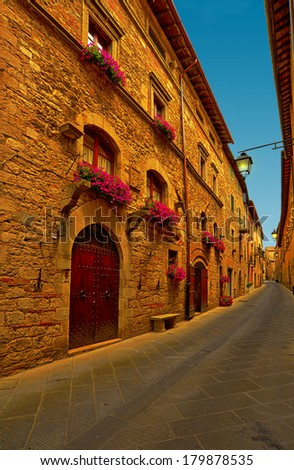 Narrow Alley with Old Buildings in Italian City of Siena - stock photo