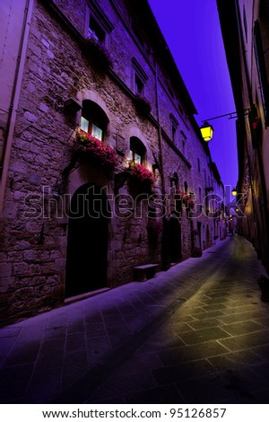 Narrow Alley With Old Buildings In Italian City of Siena at Midnight - stock photo