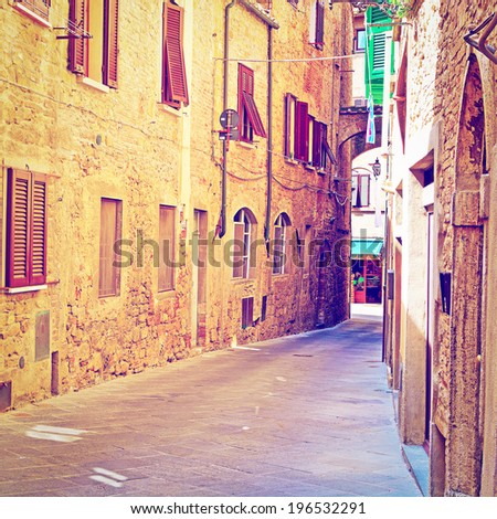 Narrow Alley with Old Buildings in Italian City of Volterra, Retro Effect - stock photo