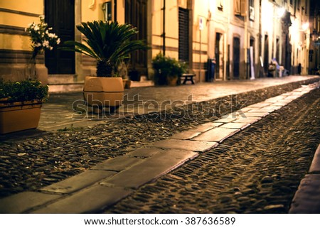 Narrow Alley With Old Buildings In Medieval Town. - stock photo