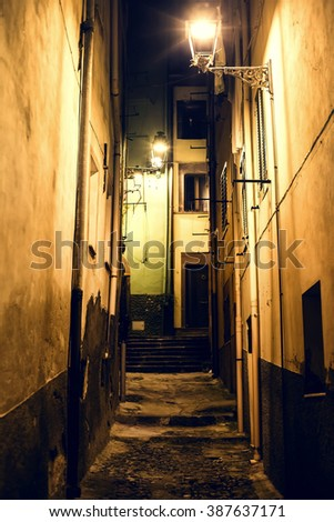 Narrow Alley With Old Buildings In Medieval Town.