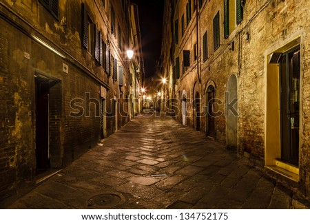 Narrow Alley With Old Buildings In Medieval Town of Siena, Tuscany, Italy - stock photo