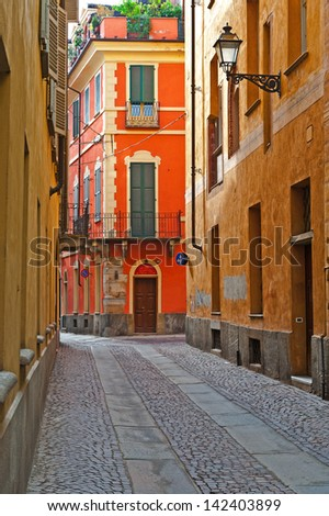 Narrow Alley with Old Buildings in the Italian City of Cuneo