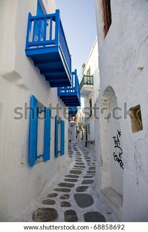 Narrow alleyway with graffiti in Mykonos, Greece