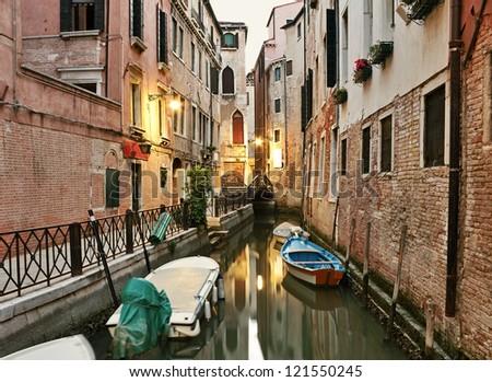 Narrow canal at early morning in Venice, Italy. - stock photo