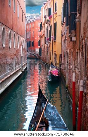 Narrow canal with gondolas in Venice, Italy - stock photo