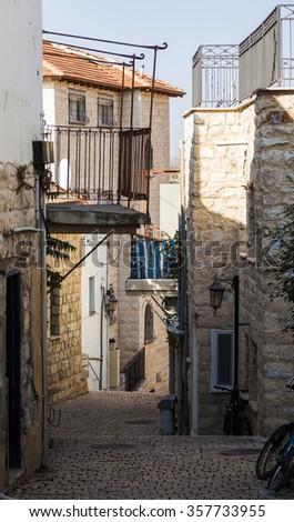 Narrow city street. Tzfat (Safed). Israel. - stock photo