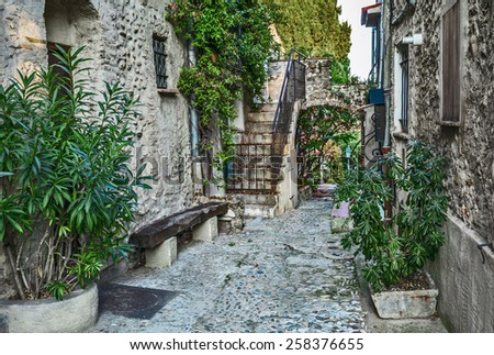 Narrow cobbled street in old town France. - stock photo