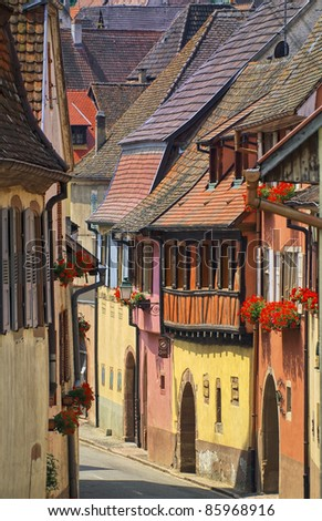 Narrow colorful street in a village by Strasbourg, Alsace, France - stock photo