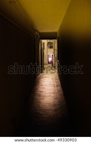 narrow dark alley, dirty grunge passage in old decadent palace of old town - stock photo