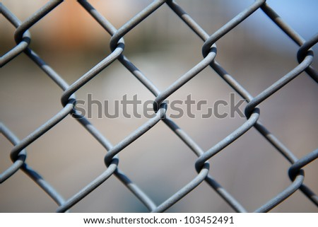 Narrow Dept of Field close up image of chain link fence - stock photo