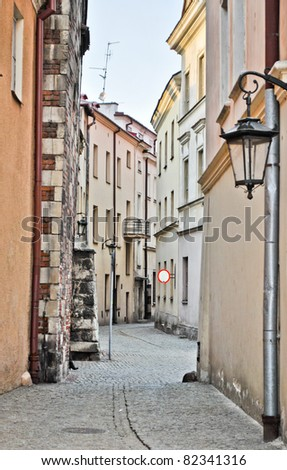 Narrow European street - stock photo