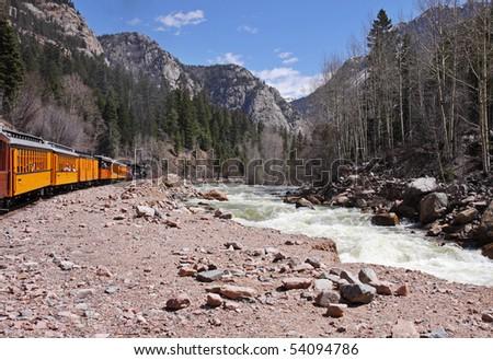 Narrow Gage Steam Railway running alongside the Animas river in the Colorado Rockies - stock photo