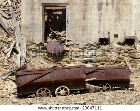 Narrow gauge miner cart abandoned near silver mine ruins in the Colorado Rockies