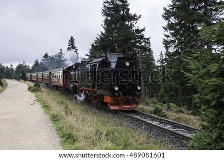 Narrow gauge steam engine from Brocken to Werningerode. The trains to the Brocken mountain are popular with tourists and operate around the year.