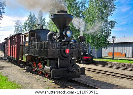 Narrow-gauge steam locomotive built in 1901 with an passenger car at the old station. Minkio, Finland - stock photo
