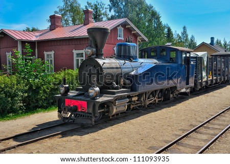 Narrow-gauge steam train pulling carriages. Minkio, Finland