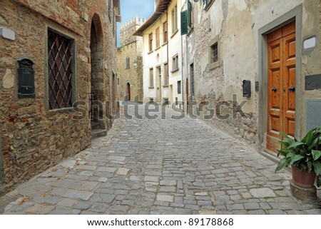 narrow italian street in tuscan borgo Montefioralle, sometimes claimed to be the birthplace of Amerigo Vespucci, Greve in Chianti, Italy, Europe - stock photo