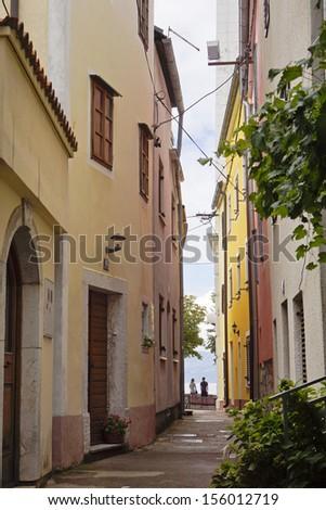 Narrow lane in a Mediterranean village - stock photo